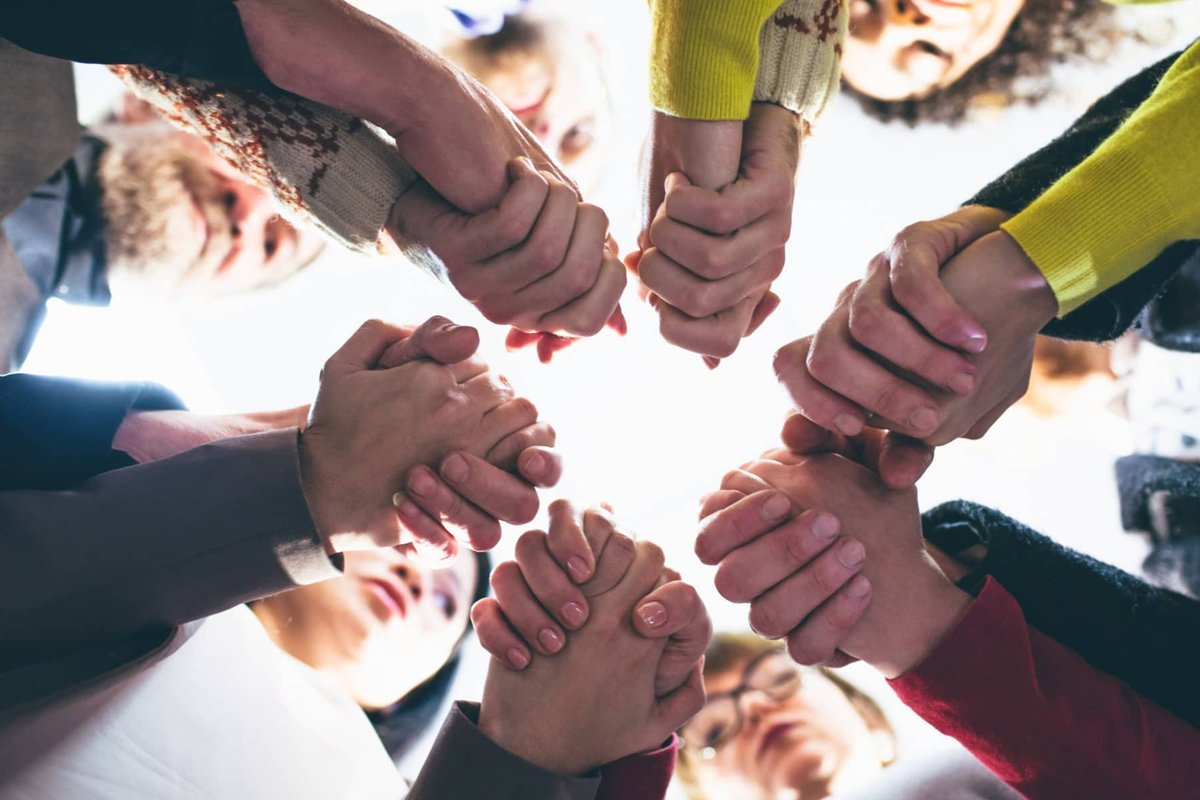 group-of-people-holding-hands