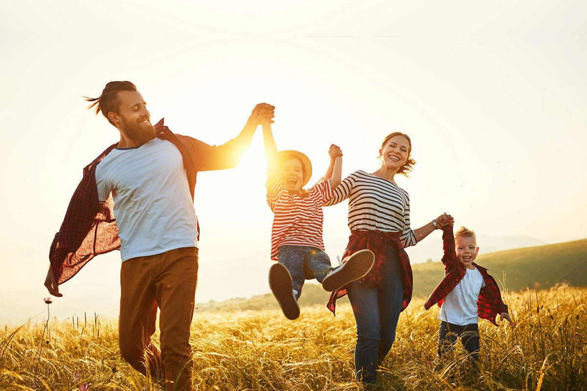 happy-family-playing-in-the-fields