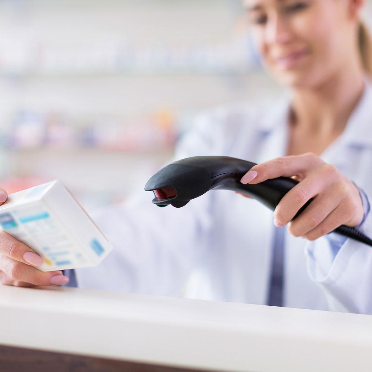 pharmacist scanning medicine