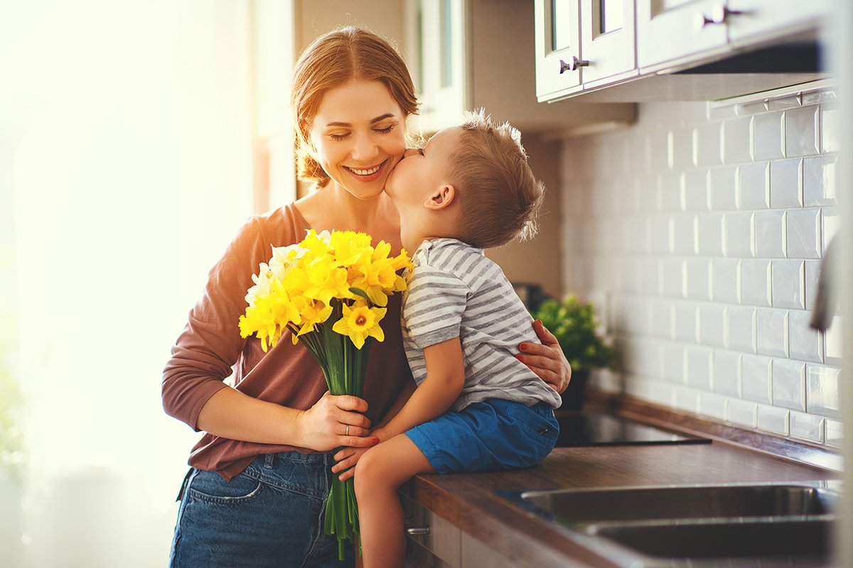 son-kissing-mom-in-kitchen