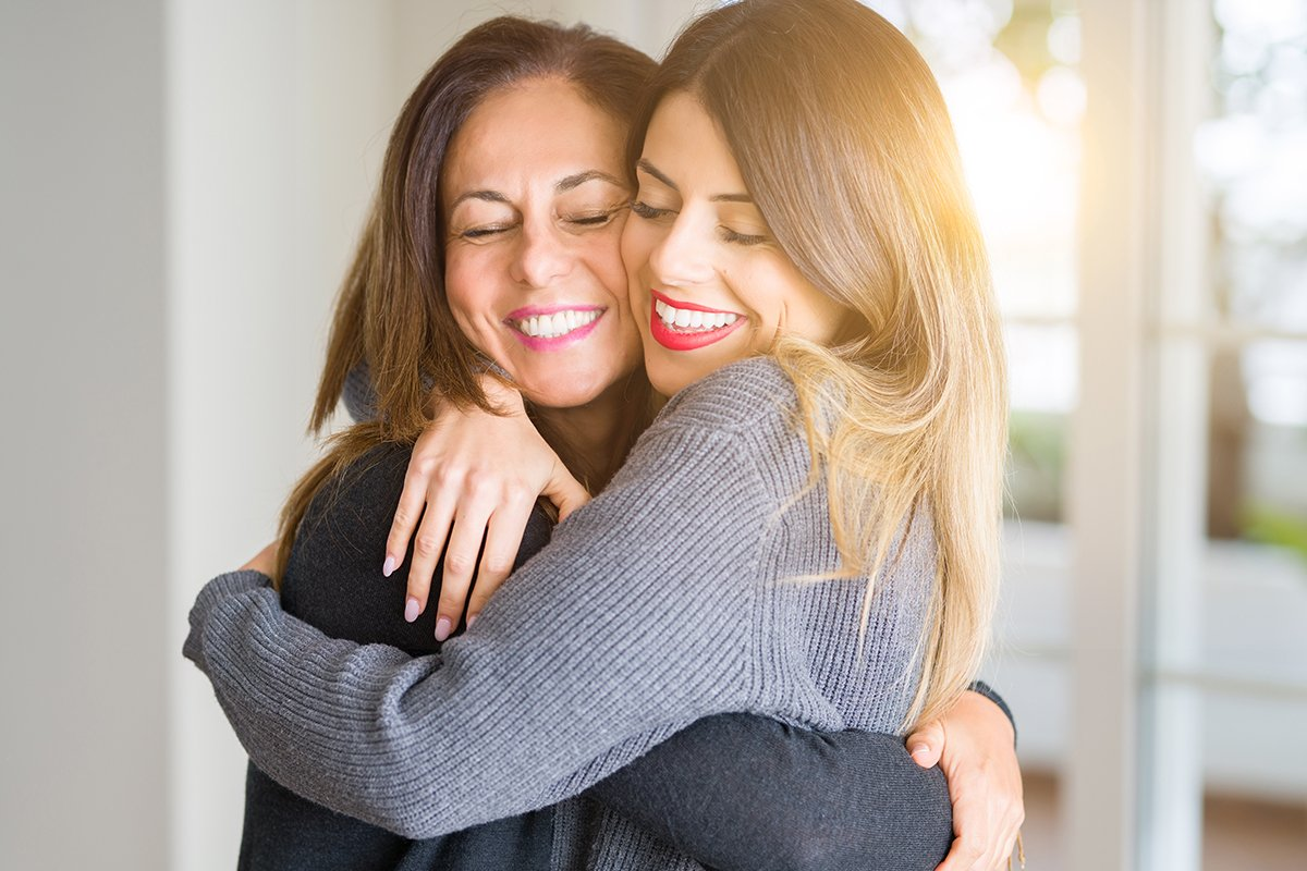 woman-hugging-happily